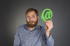 Young man with an @ symbol Stock Photography