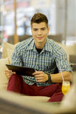 Young man with tablet Stock Photo