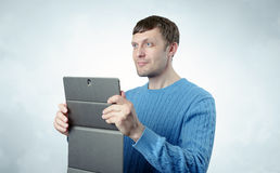 Young man with the tablet Stock Images