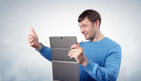 Young man with the tablet Stock Photography