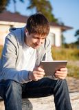 Young Man with a Tablet Royalty Free Stock Photos