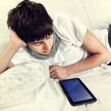 Young Man with Tablet Computer Stock Image