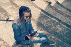 Young man with tablet Concept of new trends retro nostalgic filt Royalty Free Stock Photography
