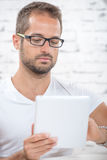 A young man with a tablet Royalty Free Stock Image