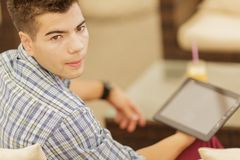 Young man with tablet Stock Images