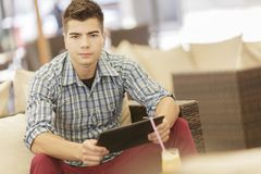 Young man with tablet Royalty Free Stock Photo