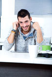 Young man with tablet in the kitchen Stock Photo