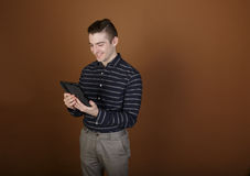 Young man with tablet Royalty Free Stock Photography