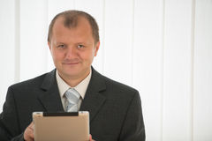 Young man with tablet pc Stock Images