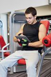 Young man with tablet pc computer in gym Stock Photography