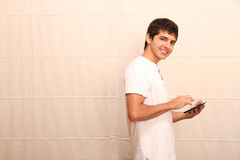 Young man with a Tablet PC Royalty Free Stock Images