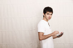 Young man with a Tablet PC Stock Image