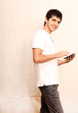 Young man with a Tablet PC Royalty Free Stock Image