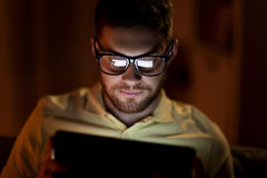 Young man with tablet pc networking at night Stock Photos