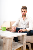 Young man with a Tablet PC on the sofa Royalty Free Stock Photos