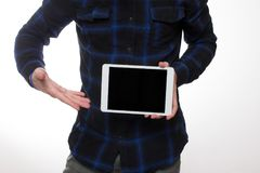 Young man with a tablet pc in the studio. Holding blank digital tablet with copy space Stock Photography
