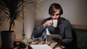 Young man with tablet pc touch in an cafe having some coffee cup Stock Photo