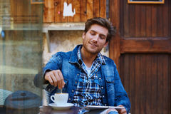 Young man with tablet pc touch in an cafe Royalty Free Stock Image