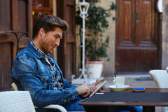 Young man with tablet pc touch in an cafe Royalty Free Stock Photography