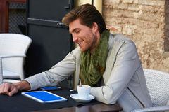 Young man with tablet pc touch in an cafe Stock Photos