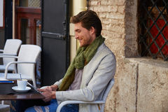 Young man with tablet pc touch in an cafe Royalty Free Stock Images