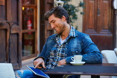Young man with tablet pc touch in an cafe Stock Photography