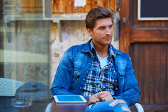 Young man with tablet pc touch in an cafe Stock Photo