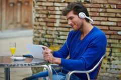 Young man with tablet pc touch listening music Stock Photo