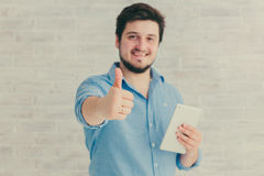 Young man with tablet. In Studio Royalty Free Stock Image