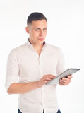 Young man with tablet Stock Photography