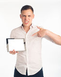 Young man with tablet Stock Image