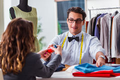 The young man tailor working with female client Stock Photo