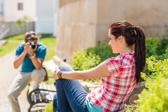 Young man take photo of his girlfriend Royalty Free Stock Image