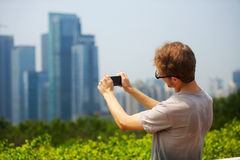 Young man take pictures on the phone Stock Images