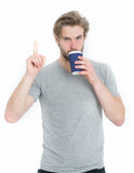 Young man with takeaway cup drinking coffee or tea, idea Stock Image
