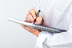 Young man takes notes Royalty Free Stock Photography
