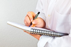Young man takes notes Stock Image