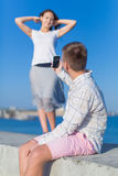 Young man takes photo his girlfriend Stock Photo