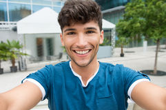 Young man takes a selfie Stock Photography
