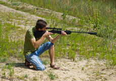 Young man taking aim with the air rifle Stock Photography