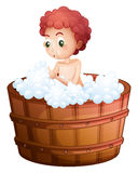 A young man taking a bath Stock Image