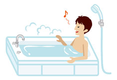 Young man taking a bath Stock Images