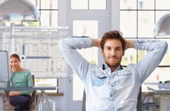 Young Man Taking Break Of Work At Architect Office Stock Photo