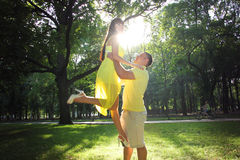 Young man taking his girlfriend on hands Royalty Free Stock Image