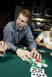 Young man taking his winnings stock image