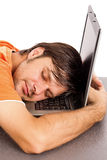 Young man taking a nap on his laptop Stock Image