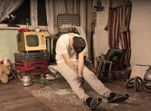 Young Man Taking a Nap at Messy Abandoned Room Royalty Free Stock Photos