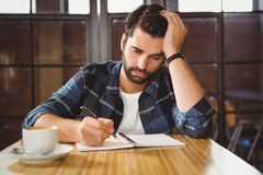 Young man taking notes in his notebook Stock Photos