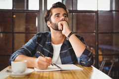 Young man taking notes in his notebook Royalty Free Stock Images