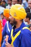 Young man taking part in Guru Nanak Gurpurab procession in Delhi Stock Image
